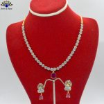 American Diamond & Faux Ruby Studded Floral Necklace and Earrings Set For Women