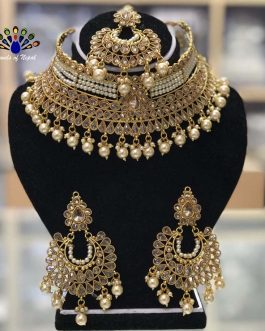 High Gold Faux Moti And Kundan Stones Embellished Adjustable Choker Necklace Set With Earrings & Maangtika