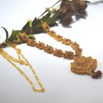 Golden/Red Stones Studded Gold...