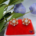 American Diamond Stoned Gold Plated Flower Designed Ear Studs For Women