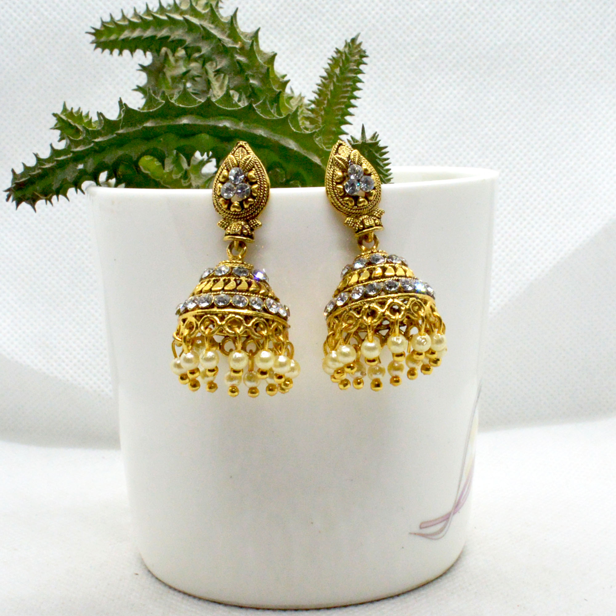 Golden Ethnic Style Stone Studded Pinjada Earrings For Women